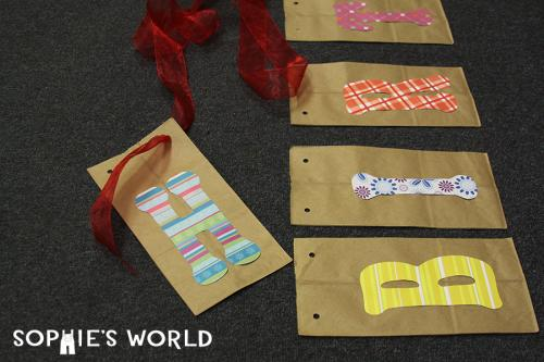The fourth step in making a birthday banner from sophie's world