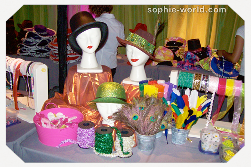 A table full of hat decorating supplies from sophie's world