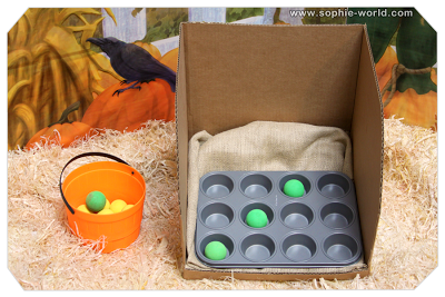Play muffin tin toss at your Fall Carnival|sophie-world.com