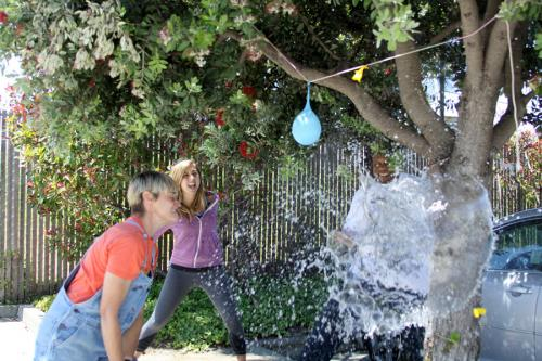 Breaking a water balloon pinata at sophie's world