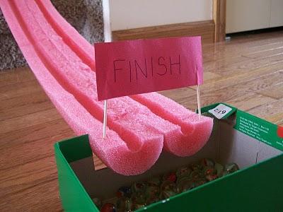 Make a marble race ttack with foam swim noodles via Sophie-World.com